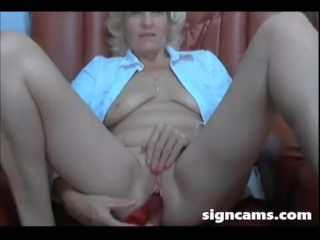 Horny Blonde Mature Fucks Pussy With Red Toy