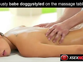 Busty babe doggystyled on the massage table