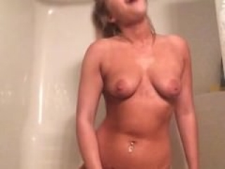 Young blonde masturbates in the shower