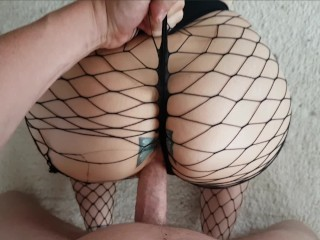 Sexy MILF with Shaved Pussy and big ass in mesh tights rides on his cock