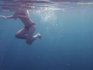Underwater in the sea young babes swimming nude