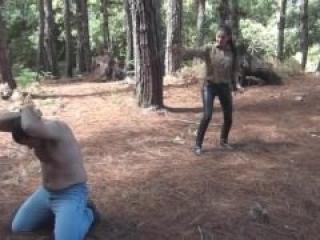 Domina whipping in the woods
