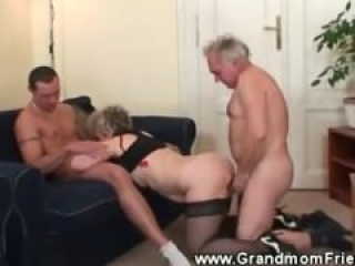 Horny granny loves her two cocks to suck and fuck