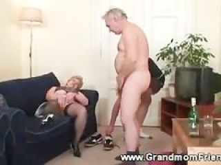 Horny granny gets a second cock to suck on