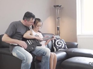 OLD4K. Old guitarist permits young fan to play with his instrument