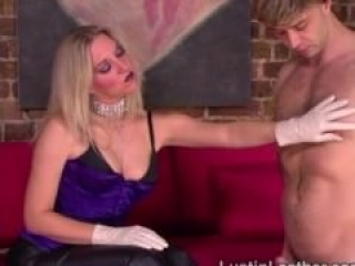 Domina tests her gloves on slaves cock