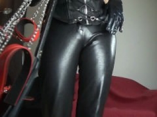 Leather Mistress Cuffs you with chains - Domina Lola