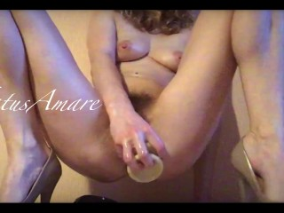 Petite blonde rides a huge dildo while fucking her cunt with a smaller one till she comes squirting