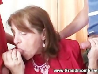 Slutty granny gets fucked by two guys