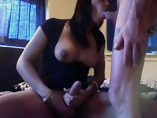 Busty brunette ladyboy devouring a whole cock