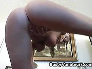 Busty Lisa masturbates her pussy with toy