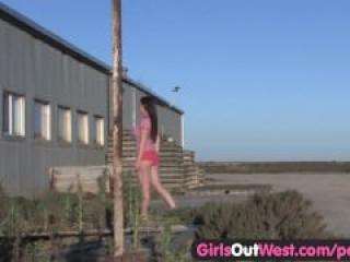 Girls Out West – Busty brunette masturbating outdoors